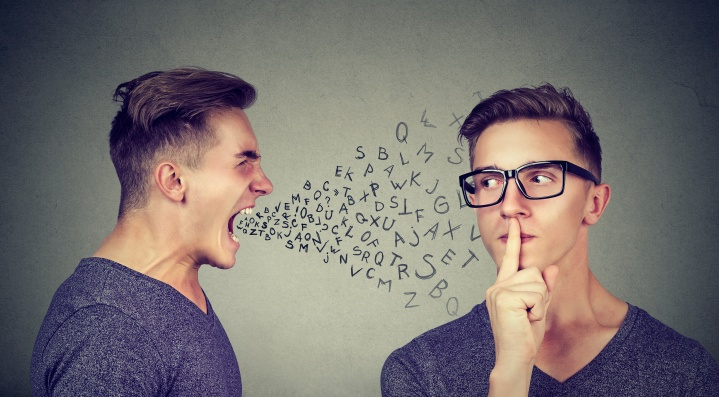 Men having conflict trying to solve problem